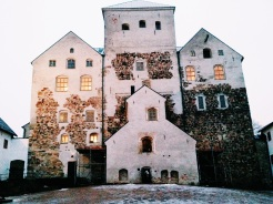 """10. The Turku Castle was constructed in the Middle Ages as a defensive fortress. There have been rounds of refurbishments after wars and fires, though the structure of the buildings has remained unchanged. Walking through the main castle and the bailey (an extension with additional fortifications) was therefore pretty surreal, and very spooky. The sun had already set when I arrived, and the rooms in the stone castle were dimly lit to give the """"medieval feel"""". I sauntered speedily through empty hallways, curious collections of dolls, and unnerving prison cells, but all the collections made for a good conclusion to the Turku trip."""