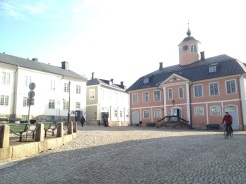 "4. The Porvoo Museum, in the middle of the ""Old Town"" of Porvoo. The Holm House is on the left of the photograph, and the Old Town Hall is on the right."
