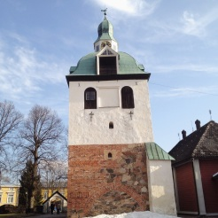 7. Porvoo's Little Church, and the bell tower of the Porvoo Cathedral. The Porvoo Cathedral, situated next to these buildings, is not in the photograph.