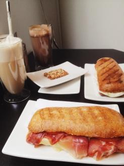 3. Lunch of toasted sandwiches: prosciutto pesto and tomato mozzarella.