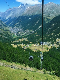 12. The small cable car for the first segment of the journey. Visitors are rewarded with views of the Alpine range, the Matterhorn, as well as the village of Zermatt (in the background).
