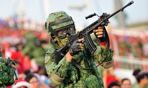 Taken from http://images.humanresourcesonline.net.s3.amazonaws.com/wp-content/uploads/2014/09/SabrinaZolkifi-Aug-2014-national-service-ns-soldier-singapore-shutterstock.jpg.