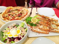 11. Food is great in Venice. Before the end of the day we had dinner – of grilled scampi, a prosciutto and mushroom pizza, and a shrimp salad – at a restaurant near the canal.