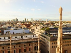 18. I was up at the rooftop during the sunset. On both sides of the cathedral there are panoramic views of the city, and on a clear day – which I enjoyed – the landscape of Milan can be observed, and in the distance the Italian Alps can also be seen.