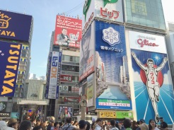 4. Along the Dōtonbori canal is a billboard of the Glico man, where many congregate. There are also many signboards and large plastic figures promoting different brands.