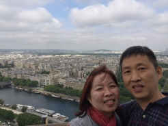 14. Parents posing for a photograph at the Eiffel Tower. Try to make an early visit: The ticket queues itself may not be long, but if there are too many people later in the day you may have to wait longer for the elevators (not for the stairs), and taking photographs may be a hassle.