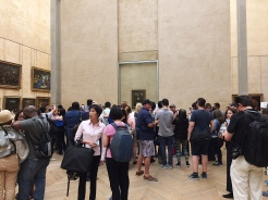 """22. Unsurprisingly, the """"Mona Lisa"""" was the most popular painting on display. Here is a photograph of different photographers taking a photograph of da Vinci's masterpiece."""