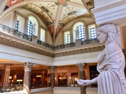 9. The interior of the Forum Shops Mall, which is connected to Caesars Palace. The architecture is characterised by Roman features, including statues, fountains, and interesting marbled seats and benches.