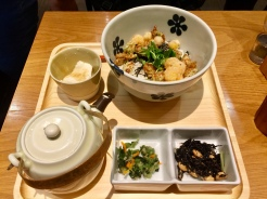 11. This is chazuke, which is prepared by pouring dashi or a soup stock over cooked rice. This came with little bits of fried seafood: Shrimp, scallops, and fishcakes.