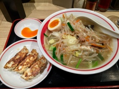 15. Ramen served with pork and plenty of vegetables, with a side of gyozas, or pan-fried dumplings.