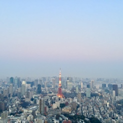 6. View of the Tokyo Tower from the Sky Deck. In the evening, one side of the deck offers a great scene of the setting sun behind a mountain range, while the other side the tower - which is lit up from 6pm onwards - is the highlight.