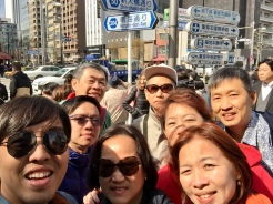 30. With the group outside the Tsukiji Fish Market, which offers a wide variety of foodstuffs, souvenirs, and freshly cooked seafood.